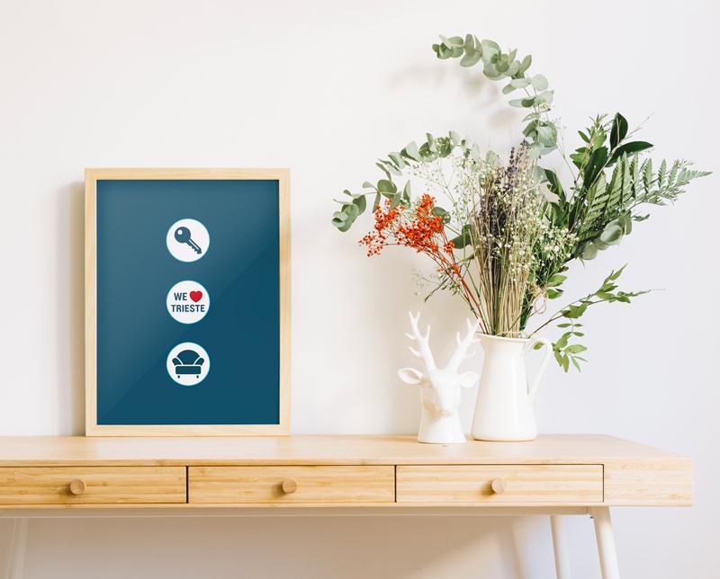 grafica comunicazione aziendale tavolo con poster trieste villas