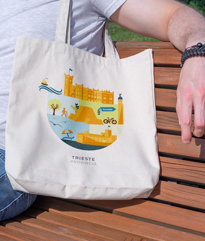 Uomo con borsa di tela stampata con illustrazione