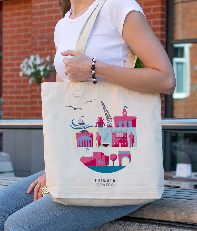 Donna con borsa di tela stampata con illustrazione