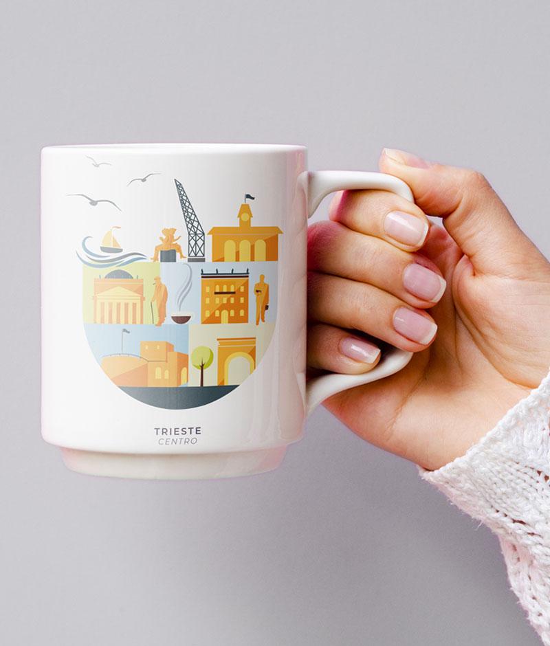 Mano tiene una tazza con stampa illustrata